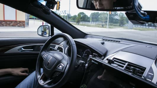 Shoabing Xu, a postdoctoral research fellow, sat in the driver's seat as a safety precaution during a demonstration of an autonomous car at the MCity testing grounds at the University of Michigan in Ann Arbor, Mich., July 6, 2017.