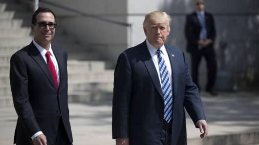 President Donald Trump (R) and Treasury Secretary Steven Mnuchin walk out of the Treasury building, April 21, 2017.
