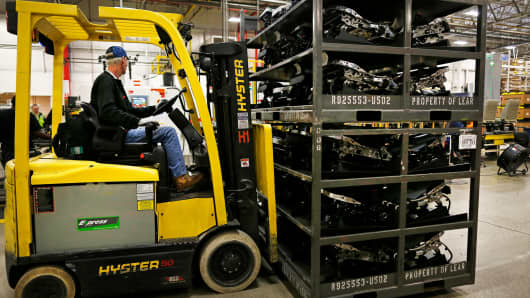 A worker operates a forklift to move parts used to assembled car seats at the Lear Corp. manufacturing facility in Hammond, Indiana.