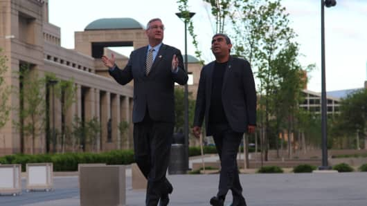 Indiana Gov. Eric Holcomb and Infosys CEO Vishal Sikka tour the grounds of the Indiana Statehouse.