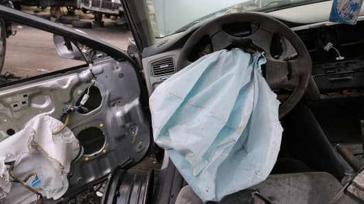 A deployed airbag is seen in a 2001 Honda Accord at the LKQ Pick Your Part salvage yard on May 22, 2015 in Medley, Florida.