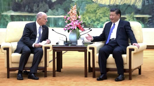 Chinese President Xi Jinping meets with California Gov. Jerry Brown at the Great Hall of the People in Beijing on July 6, 2017