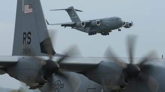 U.S. Air Force planes ferrying men and equipment of the U.S. Army 173rd Airborne Brigade arrive at a Polish air force base on April 23, 2014 in Swidwin, Poland.