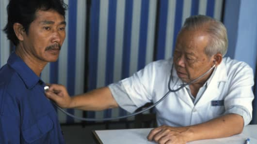 A doctor with a patient in Vietnam.