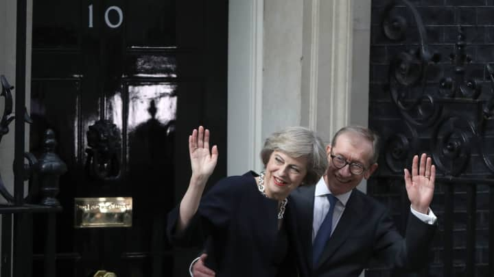 Newly appointed Prime Minister Theresa May with her husband Philip arrives to take up residence in 10 Downing Street on July 13, 2016 in London, England.