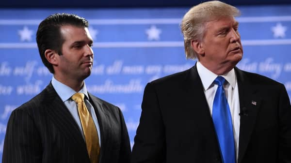 Donald Trump (R) stands with his son Donald Trump Jr. after the first presidential debate at Hofstra University in Hempstead, New York on September 26, 2016.