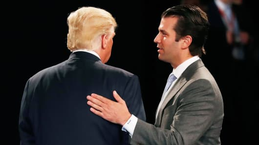 Donald Trump, Jr. (R) greets his father Republican presidential nominee Donald Trump during the town hall debate at Washington University on October 9, 2016 in St Louis, Missouri.