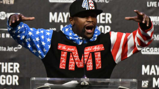 Floyd Mayweather Jr. speaks about the upcoming fight against UFC fighter Conor McGregor during a press call at the Staples Center in Los Angeles, California on July 11, 2017.