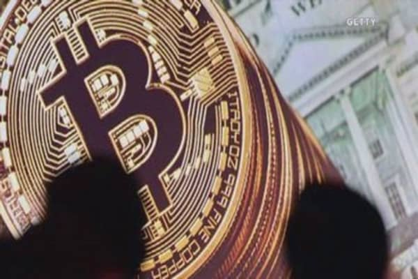 Bitcoin falls to near one-month low with $12 billion wiped off value since record high 30 days ago