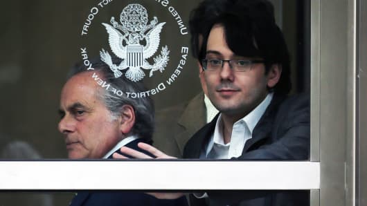 Martin Shkreli, former chief executive officer of Turing Pharmaceuticals AG, right, exits federal court with his attorney Benjamin Brafman in the Brooklyn borough of New York, June 29, 2017.