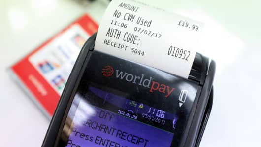 A Worldpay Group Plc card payment machine prints a receipt in a retail outlet.