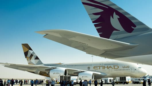 Airbus A380-800, manufactured by Airbus SAS and operated by Qatar Airways and Etihad Airways.