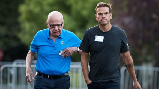 (L to R) Rupert Murdoch, executive chairman of News Corp and chairman of Fox News, and Lachlan Murdoch, co-chairman of 21st Century Fox, walk together as they arrive on the third day of the annual Allen & Company Sun Valley Conference, July 13, 2017 in Sun Valley, Idaho.