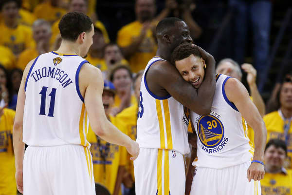 Green with teammates Stephen Curry and Klay Thompson