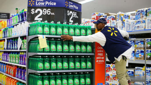 A worker sets up a display in a Walmart Super Center in Compton, California.