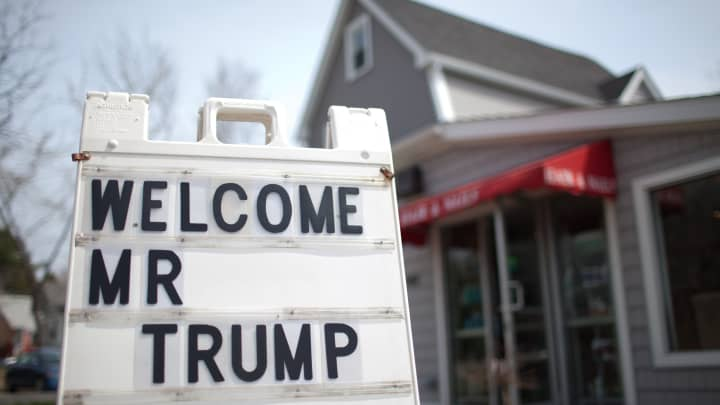 In 2011, a sign outside a hair salon welcomes Donald Trump on April 27, 2011 in Portsmouth, New Hampshire.