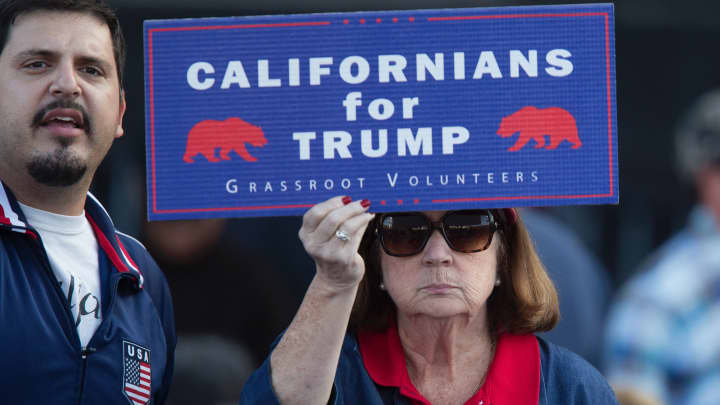 A supporter of Republican presidential candidate Donald Trump holds a sign during his campaign rally at the Orange County Fair and Event Center, April 28, 2016, in Costa Mesa, California.