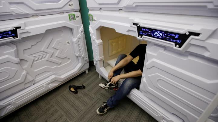 An IT employee takes of his shoes at Xiangshui Space in Beijing's Zhongguancun area, China on July 11, 2017.