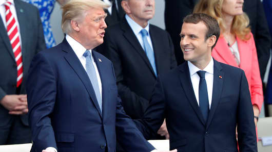 French President Emmanuel Macron and U.S. President Donald Trump attend the traditional Bastille Day military parade on the Champs-Elysees in Paris, France, July 14, 2017.
