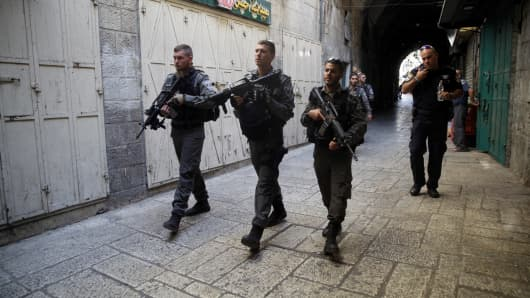 Israeli forces take security measurements after three Palestinian men's, who were allegedly attempted a shooting attack and shot dead by Israeli forces, death at Al-Aqsa Mosque in Jerusalem on July 14, 2017.