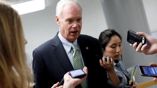 Sen. Ron Johnson (R-WI) speaks with reporters about the Senate health care bill on Capitol Hill in Washington, July 12, 2017.