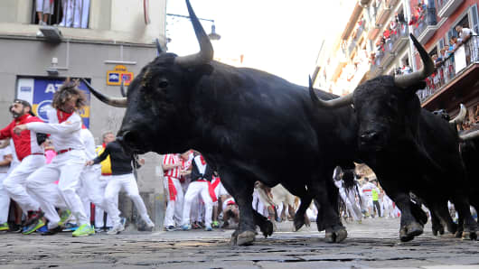 articipants run ahead of Victoriano del Rio's fighting bulls during the sixth bull run of the San Fermin festival in Pamplona,