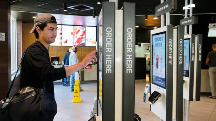 Brandon Alba from Milwaukee orders food at a self-service kiosk at a McDonald's restaurant in Chicago.