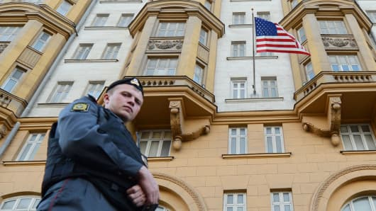 A Russian police officer patrols a street in front of the US Embassy in Moscow.
