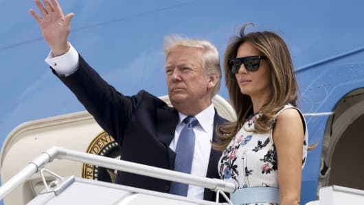 President Donald Trump and First Lady Melania Trump board Air Force One prior to departing Paris Orly Airport on July 14, 2017.