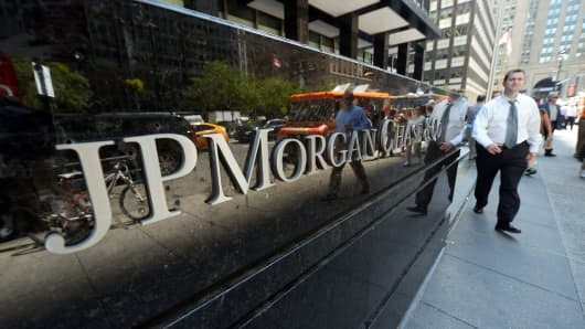 People walk by JP Morgan Chase & Company headquarters in New York