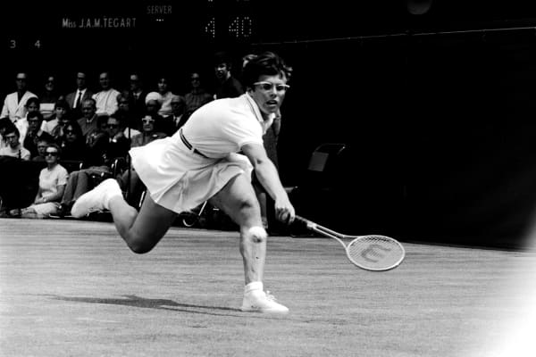Billie Jean King stretches to reach the ball in the 1968 Wimbledon final.