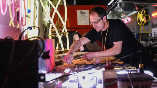 Owner David Ablon bends glass tubing at the Precision Neon studio the Brooklyn borough of New York.