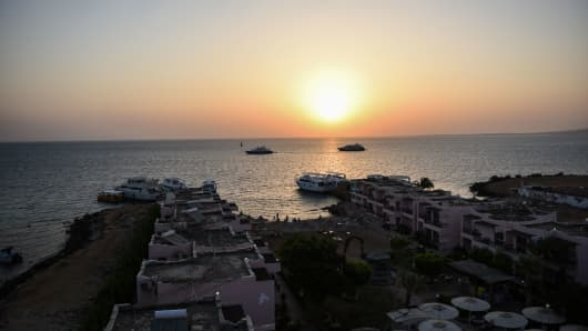 The sun rises July 15, 2017 over one of the beaches in the city of Hurghada, Egypt, where the previous day an Egyptian man stabbed two German tourists to death and wounded four others. Although the attacker's motives were unclear, the stabbing will come as a blow to Egypt which has been trying to woo back tourists after years of unrest and deadly attacks.