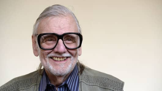 American film director George Romero poses for a photo during the Lucca Film Festival on April 7, 2016 in Lucca, Italy.