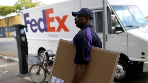 A FedEx delivery person in Miami, Florida.