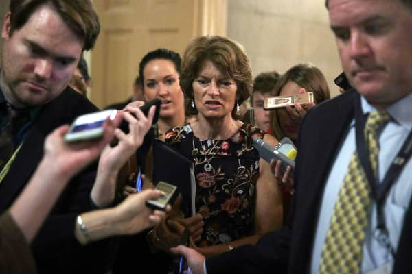 U.S. Sen. Lisa Murkowski (R-AK)) is surround by members of the media as he is on his way to view the details of a new health care bill July 13, 2017 at the Capitol in Washington, DC.