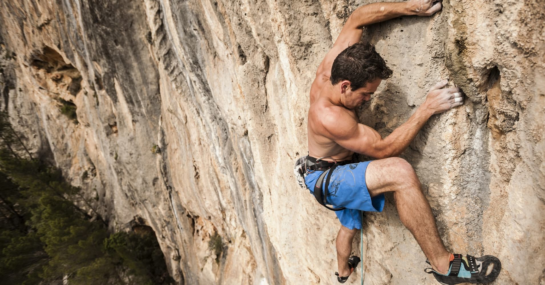 Italian climber Lucas Iribarren climbs a project route on limestone during a climbing trip to Mallorca, Spain.
