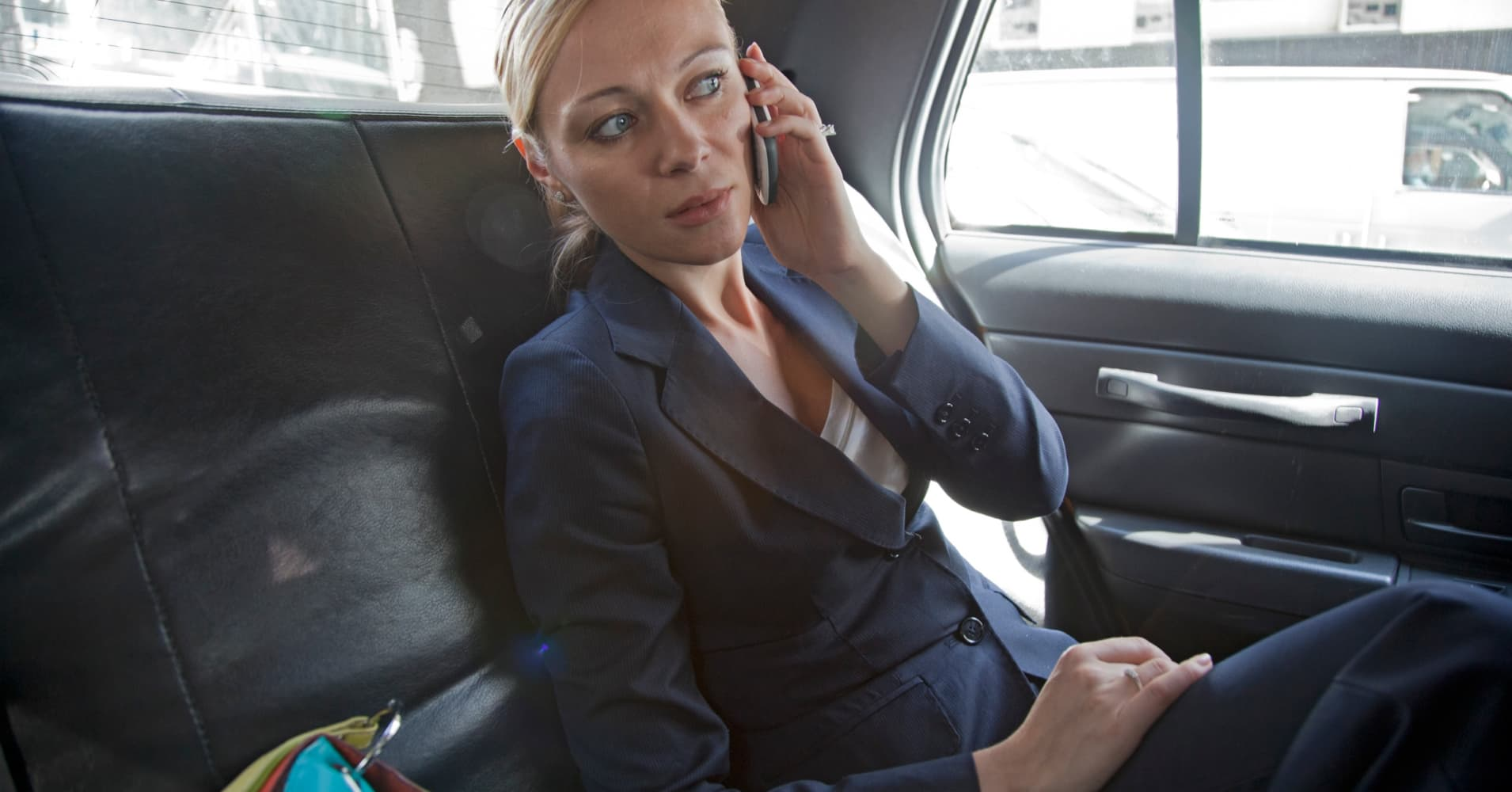Businesswoman commuting in taxi