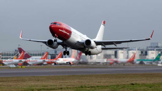A Boeing 737 passenger aircraft, operated by Norwegian Air Shuttle ASA, takes off at London Gatwick Airport in Crawley, U.K.