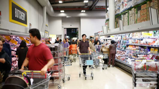 People shop for groceries in a supermarket in Auckland, New Zealand on April 14, 2017.