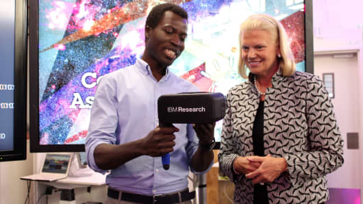 IBM CEO Ginni Rometty, right, with IBM research scientist Geoffrey Siwo.