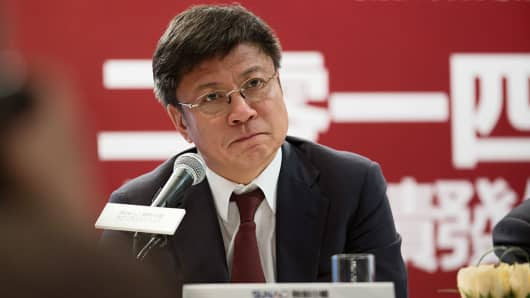 Sun Hongbin, chairman and chief executive officer of Sunac China Holdings, listens during a news conference in Hong Kong, China, on March 24, 2015.