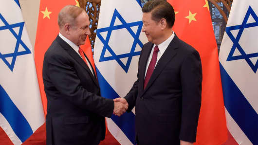 Chinese President Xi Jinping (R) and Israeli Prime Minister Benjamin Netanyahu (L) shake hands ahead of their talks at Diaoyutai State Guesthouse on March 21, 2017 in Beijing, China.
