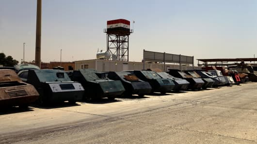 Vehicles used for suicide car bombings, made by Islamic State militants, are seen at Federal Police headquarters after being confiscated in Mosul.
