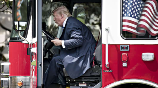 President Donald Trump sits in a fire truck while participating in a Made in America event, with companies from 50 states featuring their products, on the South Lawn of the White House in Washington on Monday, July 17, 2017.