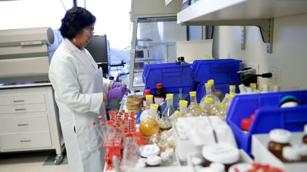 A scientist at Vertex Pharmaceuticals works in her laboratory in San Diego.
