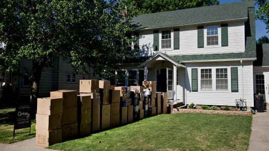Moving boxes sit stacked outside of a home in Princeton, Illinois.