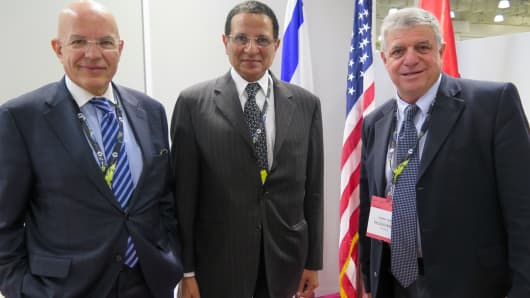 Egypt's Muhamed Kassem of World Trading Company and Ashraf El Rabiey, head of Egypt's Qualified Industrial Zones meet with Israel's Gabby Bar, co-chairman of Israel's QIZ at TexWorld USA.