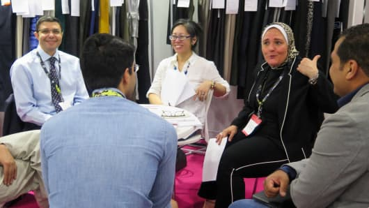 Representatives meet at the TexWorld USA conference at an Egyptian textile booth.