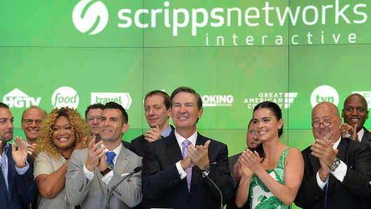 John Colaneri, Anthony Carrino, Sunny Anderson, Kenneth W. Lowe, Katie Lee, Andrew Zimmern and guests of Scripps Networks Interactive ring the NASDAQ Opening Bell at NASDAQ on June 2, 2016 in New York City.